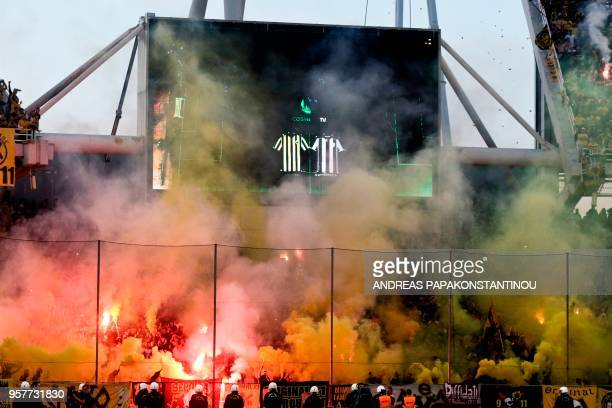 AEF FC' fans hold flares ahead of a Greek Cup Final between AEK Athens FC and PAOK Salonika at the Olympic stadium in Athens on May 12 2018
