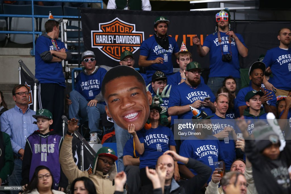 Fans hold Giannis Antetokounmpo #34 of the Milwaukee Bucks poster during the game against the Detroit Pistons on December 6, 2017 at the BMO Harris Bradley Center in Milwaukee, Wisconsin.