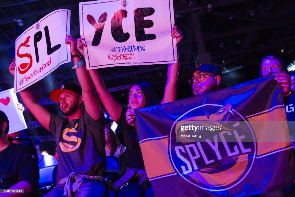 Fans hold placards and a banner in support of team Splyce during the grand final game between teams Tox and Splyce at the Halo World Championship finals in Seattle, Washington, U.S., on Sunday, April 15, 2018. E-sports revenue, consisting of merchandise, event tickets, sponsorships, advertising and media rights -- all beyond game sales -- is expected to rise at a 32.2% average annual rate in 2016-20 to $1.5 billion in 2020, according to Newzoo. Photographer: David Ryder/Bloomberg via Getty Images