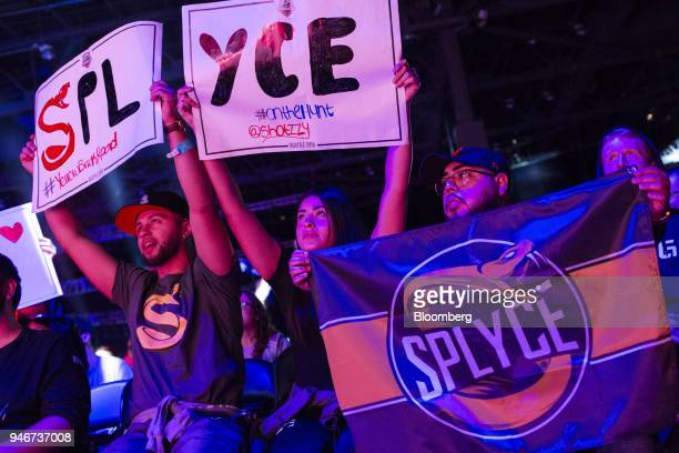 Fans hold placards and a banner in support of team Splyce during the grand final game between teams Tox and Splyce at the Halo World Championship...