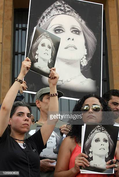 Fans hold portraits of Lebanese diva Fairuz during a sitin in Beirut on July 26 2010 following rumors that the Rahbani musical family is banning the...