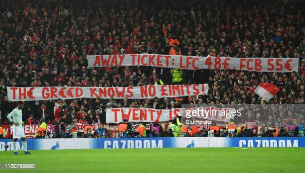 Fans hold protest banners prior to the UEFA Champions League Round of 16 First Leg match between Liverpool and FC Bayern Muenchen at Anfield on...