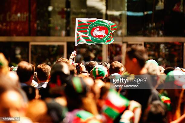 Fans hold Rabbitohs flags during a South Sydney Rabbitohs NRL Grand Final celebration at Sydney Town Hall on October 9 2014 in Sydney Australia