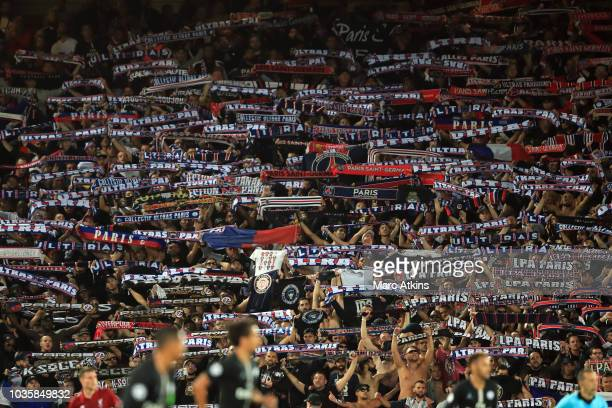 PSG fans hold scarves aloft during the Group C match of the UEFA Champions League between Liverpool and Paris SaintGermain at Anfield on September 18...
