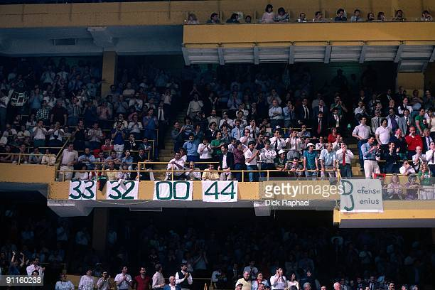 Fans hold signs draped for Larry Bird Kevin McHale Robert Parish and Danny Ainge of the Boston Celtics during a game played in 1987 at the Boston...