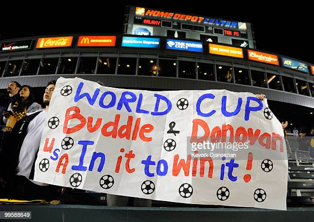 Fans hold signs during a World Cup send off ceremony for Edson Buddle and Landon Donovan of the Los Angeles Galaxy after the MLS soccer match against...