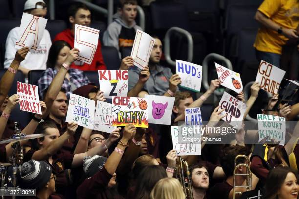 Fans hold signs during the game between the St John's Red Storm and the Arizona State Sun Devils in the First Four of the 2019 NCAA Men's Basketball...