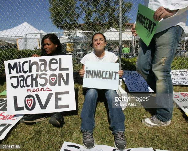 Fans hold signs for pop singer Michael Jackson at the Santa Barbara County courthouse where deliberation on Jackson's child molestation trial...