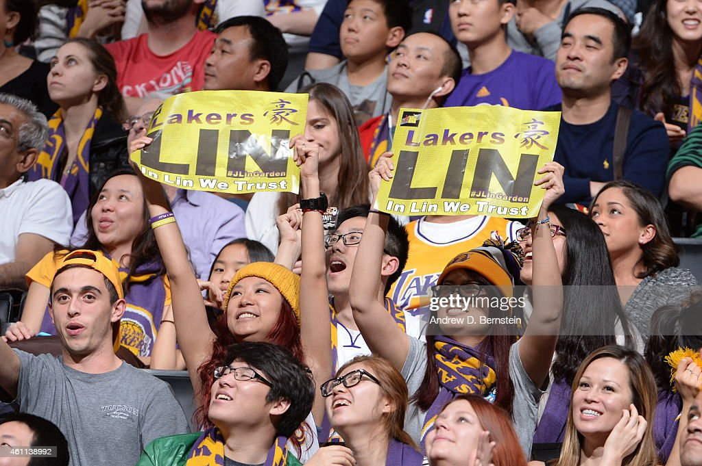 Fans hold signs in support of Jeremy Lin #17 of the Los Angeles Lakers during a game against the Golden State Warriors on December 23, 2014 at Staples Center in Los Angeles, California.