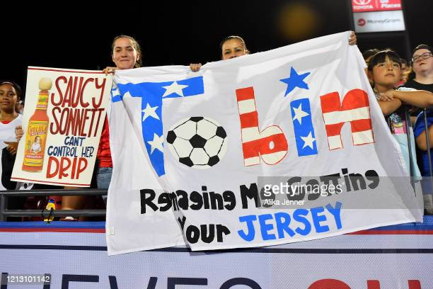 Fans hold signs supporting the United States after the SheBelieves Cup match against Japan at Toyota Stadium on March 11 2020 in Frisco Texas The...