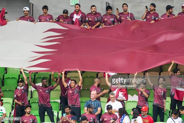 Fans hold the Qatar flag prior to the Gold Cup semifinal match between the United States and Qatar on Thursday July 29th, 2021 at Q2 stadium in...