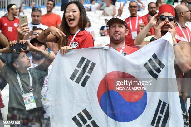 Fans hold the South Korea flag before the Russia 2018 World Cup Group A football match between Saudi Arabia and Egypt at the Volgograd Arena in...