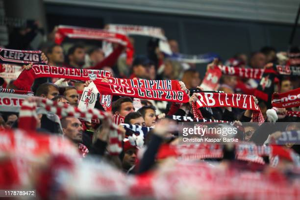 Fans hold their scarfs during the UEFA Champions League group G match between RB Leipzig and Olympique Lyon at Red Bull Arena on October 2 2019 in...