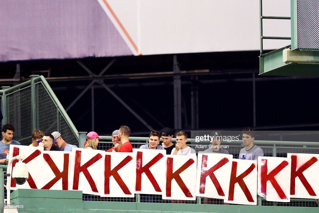 Fans hold up 10 K signs in the eighth inning to mark Chris Sale #41 of the Boston Red Sox's 10 strikeouts during a game against the Chicago White Sox at Fenway Park on June 08, 2018 in Boston, Massachusetts.