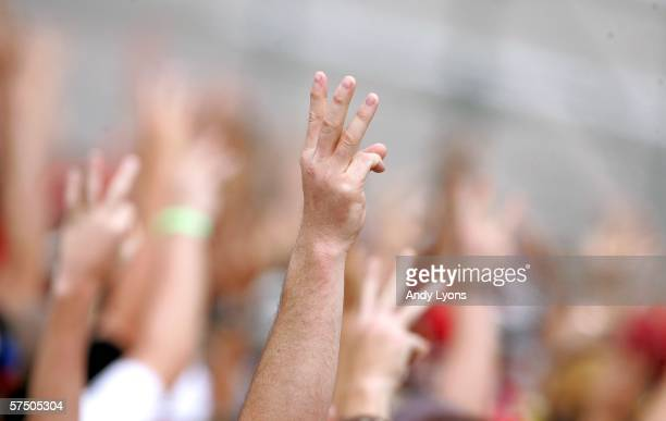 Fans hold up 3 fingers in remembrance of Dale Earnhardt during the NASCAR Nextel Cup Series Aaron's 499 at the Talladega Superspeedway on May 1 2006...