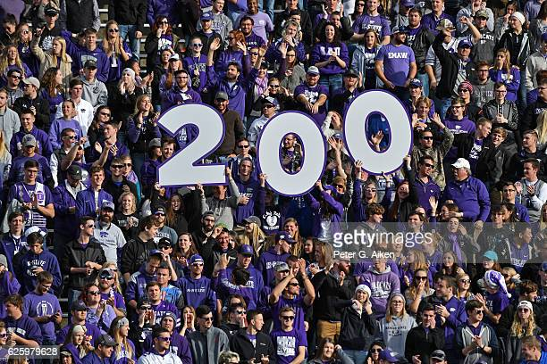 Fans hold up a 200 sign for head coach Bill Snyder's 200th career win at Kansas State after beating the Kansas Jayhawks on November 26 2016 at Bill...