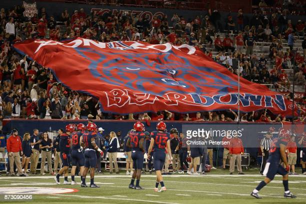 Fans hold up a Arizona Wildcats 'Beardown' flag during the second half of the college football game against the Oregon State Beavers at Arizona...