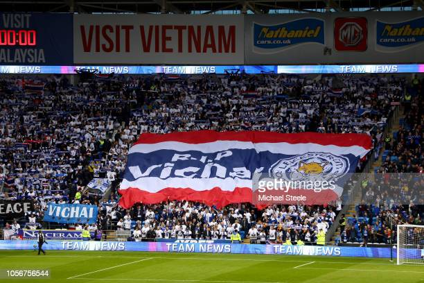 Fans hold up a baner in memory of Vichai Srivaddhanaprabha prior to the Premier League match between Cardiff City and Leicester City at Cardiff City...