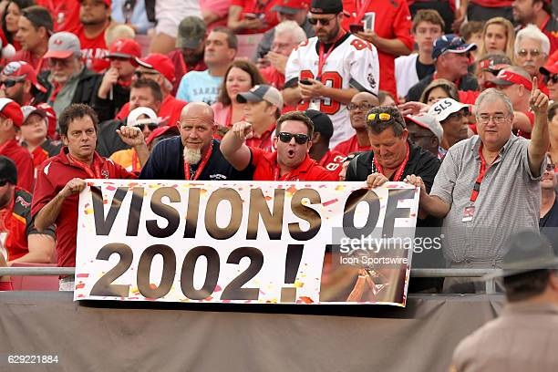 Fans hold up a banner bringing back memories of the Buccaneers 2002 season during the NFL Game between the New Orleans Saints and Tampa Bay...
