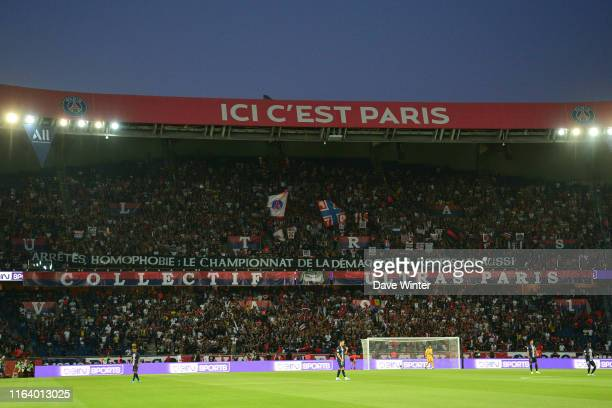 PSG fans hold up a banner denouncing matches being halted due to homophobic chanting during the Ligue 1 match between Paris Saint Germain and...
