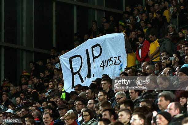 Fans hold up a banner in remembrance of the victims of Germanwings flight 4U9525 prior to kickoff during the International Friendly match between...
