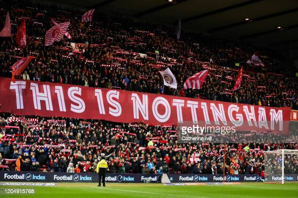 Fans hold up a banner saying this is Nottingham ahead of the Sky Bet Championship match between Nottingham Forest and Leeds United at City Ground on...