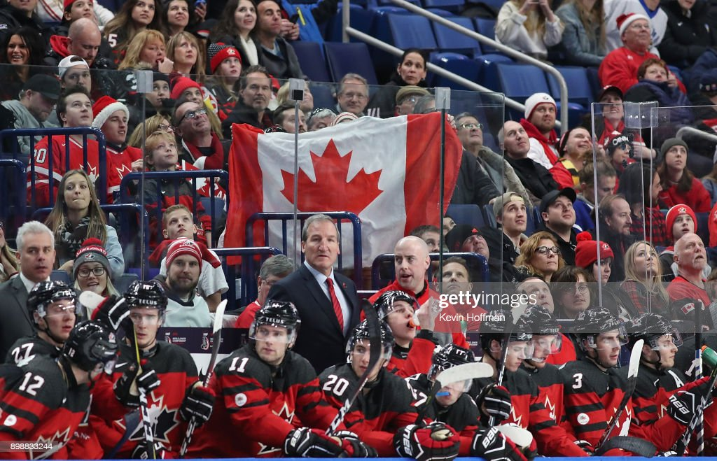 Fans hold up a Canadian flag behind the bench during the third period against Finland at KeyBank Center on December 26, 2017 in Buffalo, New York. Canada beat Finland 4-2.
