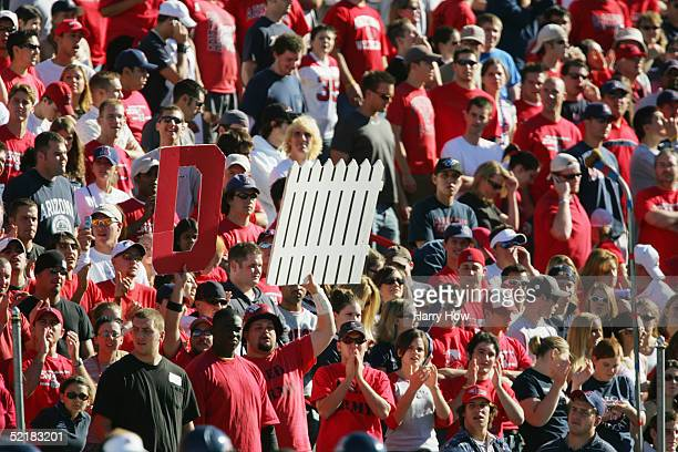 Fans hold up a defense sign during the game between the Arizona State Sun Devils and the Arizona Wildcats at Arizona Stadium on November 26 2004 in...