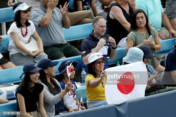 Fans hold up a flag during the Kei Nishikori of Japan and Andrey Rublev of Russia match during Day 3 of the Western and Southern Open at the Lindner...