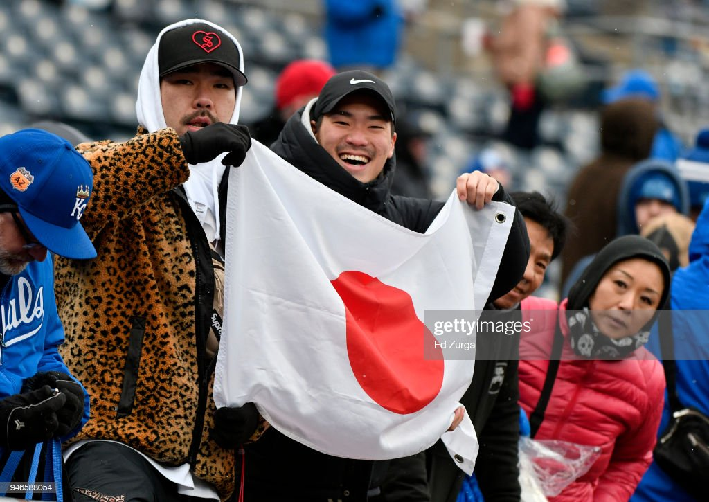 Fans hold up a flag of Japan as they wait for Japanese pitcher Shohei Ohtani #17 of the Los Angeles Angels of Anaheim to take to the field prior to a game against the Kansas City Royals at Kauffman Stadium on April 15, 2018 in Kansas City, Missouri. The game was postponed due to low temperatures.
