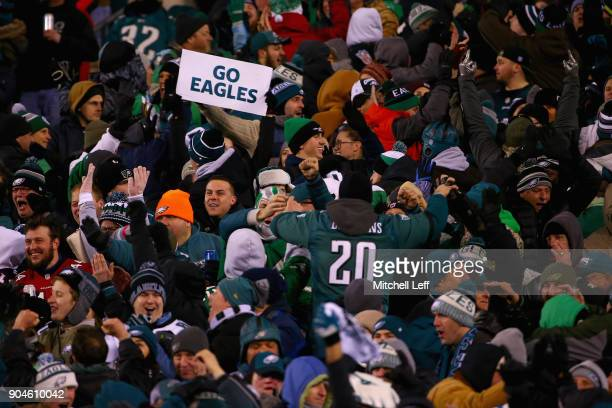 Fans hold up a 'Go Eagles' sign as the Philadelphia Eagles take on the Atlanta Falcons during the second quarter in the NFC Divisional Playoff game...