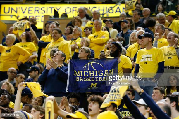 Fans hold up a Michigan Basketball banner during a regular season Big 10 Conference basketball game between the Ohio State Buckeyes and the Michigan...