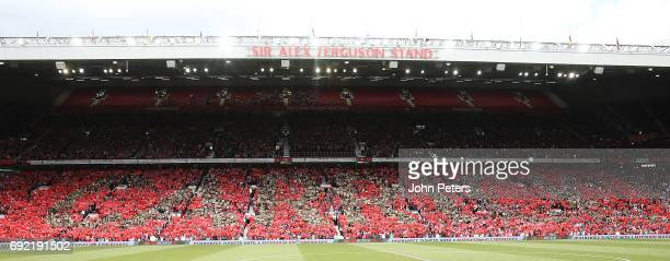 Fans hold up a mosaic reading Carrick ahead of the Michael Carrick Testimonial match between Manchester United and Michael Carrick AllStars at Old...