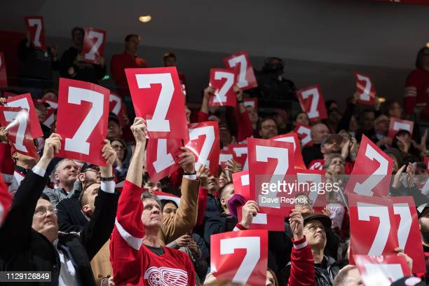 Fans hold up a number 7 sign paying tribute to the late former Detroit Red Wing Ted Lindsay during an NHL game between the Detroit Red Wings and the...