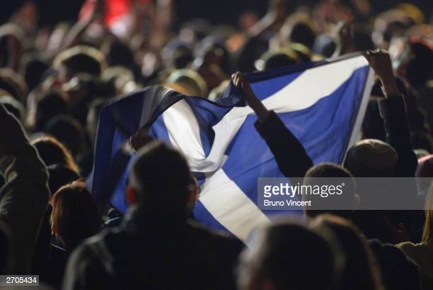 Fans hold up a Saltire during the MTV In The Gardens concert at Princes Street Gardens November 6 2003 in Edinburgh Scotland