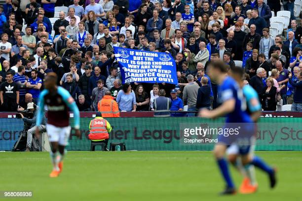 Fans hold up a sign during the Premier League match between West Ham United and Everton at London Stadium on May 13 2018 in London England