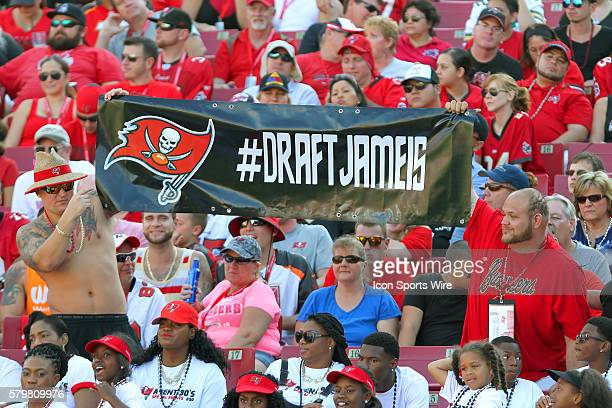 Fans hold up a sign in support for Jameis Winston of Florida State during the final regular season game of the season between the New Orleans Saints...