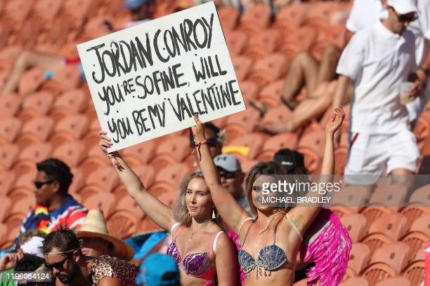Fans hold up a sign referencing Ireland's Jordan Conroy during the women's sevens rugby match between New Zealand and England during day one of the...