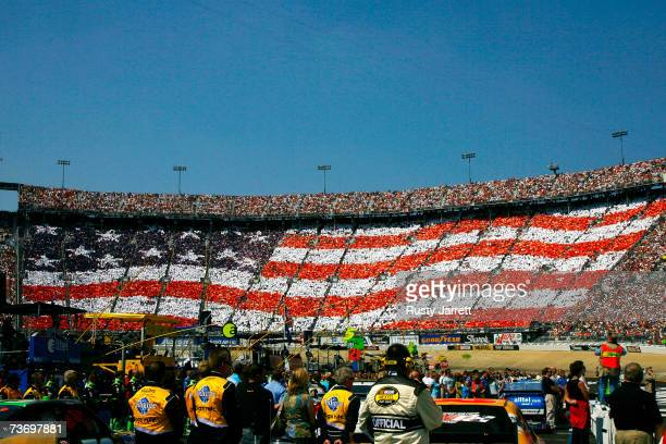 Fans hold up cards creating an american flag in the grandstands prior to the start of the NASCAR Nextel Cup Series Food City 500 at Bristol Motor...