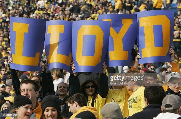 Fans hold up cards which spell Lloyd in reference to head coach Lloyd Carr of the Michigan Wolverines during the NCAA football game against the Ball...