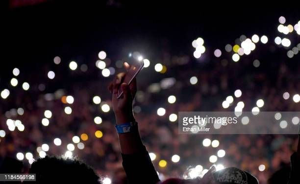 Fans hold up cell phones with lights on as they wait for a performance by Twenty One Pilots during a stop of The Bandito Tour at MGM Grand Garden...