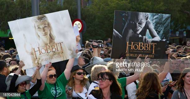 "Fans hold up Hobbit signs during the world premiere of ""The Hobbit"" movie in Courtenay Place in Wellington on November 28, 2012. Huge crowds swarmed..."