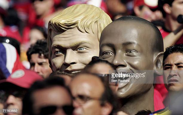 Fans hold up large caricature heads of German Goalkeeper Oliver Kahn and Paulo Wanchope of Costa Rica during the FIFA World Cup Germany 2006 Group A...