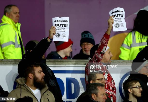 Fans hold up poster in protest against Swansea Chairman Huw Jenkins during the Premier League match between Swansea City and Crystal Palace at...