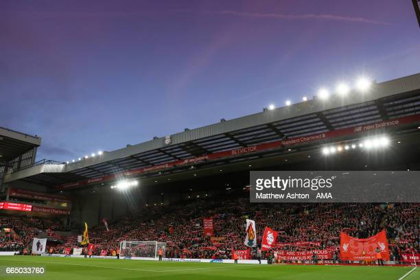 Fans hold up scarfs and banners on The Kop at Anfield Stadium the home of Liverpool during the Premier League match between Liverpool and AFC...