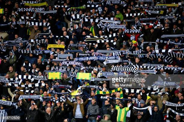 Fans hold up scarves in tribute to Cyrille Regis ahead of the Premier League match between West Bromwich Albion and Southampton at The Hawthorns on...