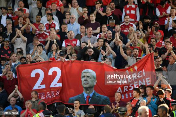 Fans hold up signs celebrating Arsene Wenger after the Premier League match between Huddersfield Town and Arsenal at John Smith's Stadium on May 13,...