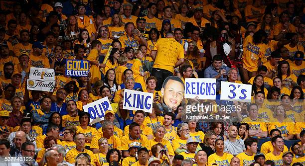 Fans hold up signs during the game between the Golden State Warriors and the Cleveland Cavaliers in Game One of the 2016 NBA Finals on June 2 2016 at...
