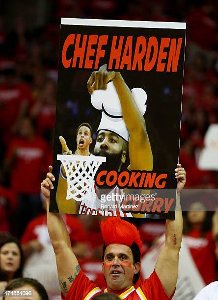 Fans hold up signs in support of James Harden of the Houston Rockets in the first quarter against the Golden State Warriors during Game Three of the...