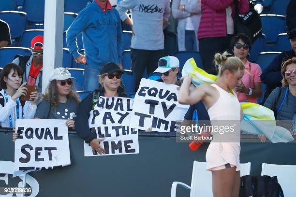 "Fans hold up signs reading, ""Equal Set, Equal Pay, Equal TV Time"", during the first round match Marta Kostyuk of Ukraine and Shuai Peng of China on..."